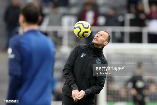 Duncan Ferguson assistant manager of Everton catches the ball on his shoulder during the warm up prior to Premier League match between Newcastle...