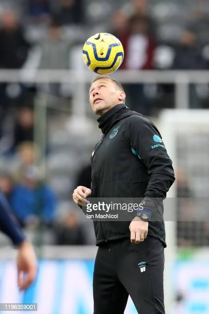 Duncan Ferguson assistant manager of Everton catches the ball on his head during the warm up prior to Premier League match between Newcastle United...