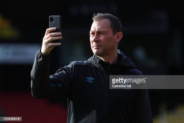 Duncan Ferguson Everton assistant manager takes a photo inside the stadium prior to the Premier League match between Watford FC and Everton FC at...