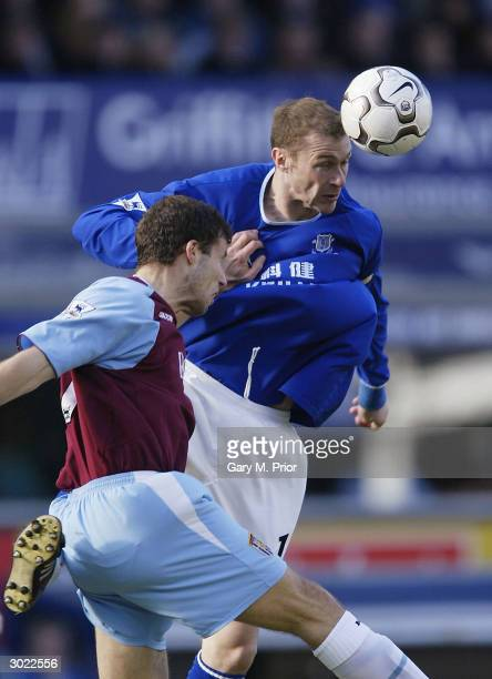 Duncan Ferguson of Everton and Ronny Johnsen of Aston Villa in action during the FA Barclaycard Premiership match between Everton and Aston Villa at...