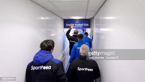 Duncan Ferguson of touches the Everton crest inside the tunnel before the Premier League match between Everton and West Bromwich Albion at Goodison...