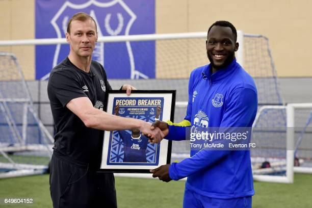 Duncan Ferguson presents to Romelu Lukaku for becoming Everton's record Premier League goal scorer at USM Finch Farm on March 8, 2017 in Halewood,...