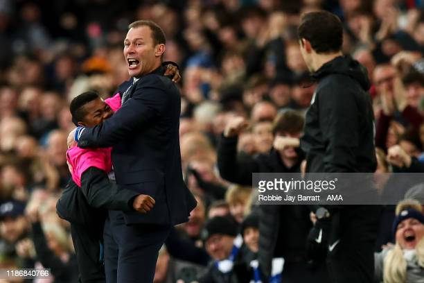 Duncan Ferguson the interim head coach / manager of Everton celebrates with a ball boy after the second goal during the Premier League match between...