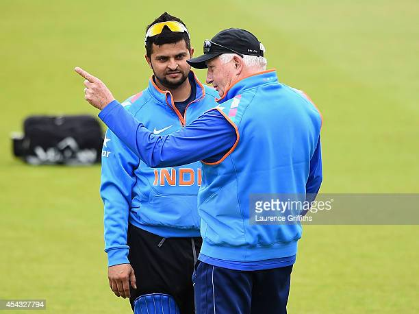 Duncan Fletcher of India talks with Suresh Raina during net practice at Trent Bridge on August 29, 2014 in Nottingham, England.