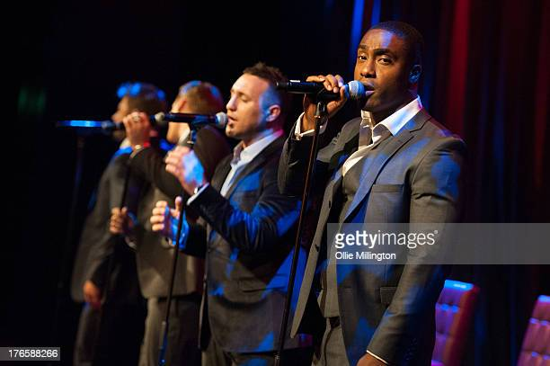 Duncan James Lee Ryan Anthony Costa and Simon Webbe of Blue perform at the premiere of the music video for the single 'Break My Heart' at Hippodrome...