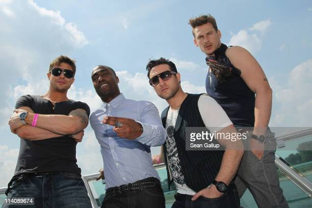 Duncan James Simon Webbe Antony Costa and Lee Ryan of the UK band Blue pose for a photo while sailing on a ship on the Rhine River during the...