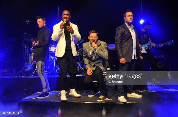 Duncan James Simon Webbe Lee Ryan and Anthony Costa of Blue perform on stage at O2 Shepherd's Bush Empire on May 3 2013 in London England