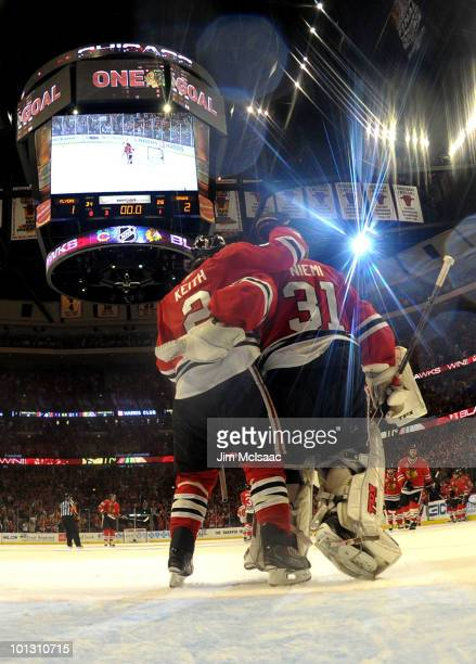 Duncan Keith and Antti Niemi of the Chicago Blackhawks celebrates after defeating the Philadelphia Flyers by a score of 21 to win Game Two of the...