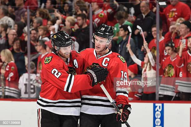 Duncan Keith and Jonathan Toews of the Chicago Blackhawks celebrate after Toews scored the game winning goal in overtime against the San Jose Sharks...