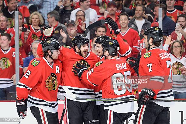 Duncan Keith, Andrew Desjardins, Marcus Kruger, Andrew Shaw and Brent Seabrook of the Chicago Blackhawks celebrate after Desjardins scored against...