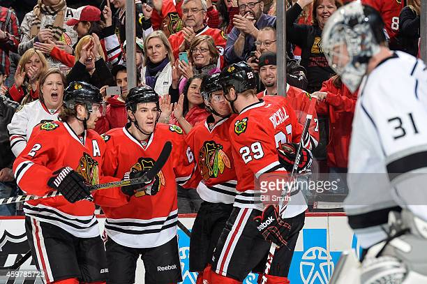 Duncan Keith Andrew Shaw Brandon Saad and Bryan Bickell of the Chicago Blackhawks celebrate after Saad scored in the first period as goalie Martin...