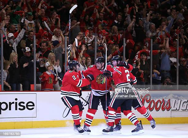 Duncan Keith Marian Hossa Jonathan Toews and Bryan Bickell of the Chicago Blackhawks celebrate Hossa's goal in the second period of Game One of the...