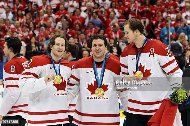 Duncan Keith Mike Richards and Chris Pronger of Canada pose for a photo after the ice hockey men's gold medal game between USA and Canada on day 17...