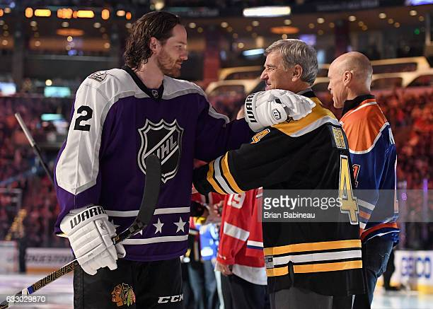 Duncan Keith of the Chicago Blackhawks and former NHL player Bobby Orr greet one another prior to the 2017 Honda NHL AllStar Game at Staples Center...