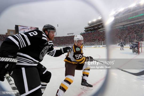 Duncan Keith of the Chicago Blackhawks and Noel Acciari of the Boston Bruins watch for the puck in the second period during the 2019 Bridgestone NHL...