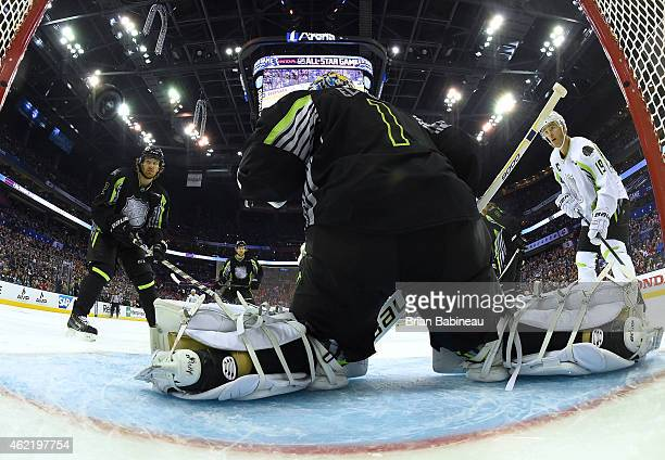 Duncan Keith of the Chicago Blackhawks and Team Foligno and Jonathan Toews of the Chicago Blackhawks and Team Toews watch the puck go into the net on...