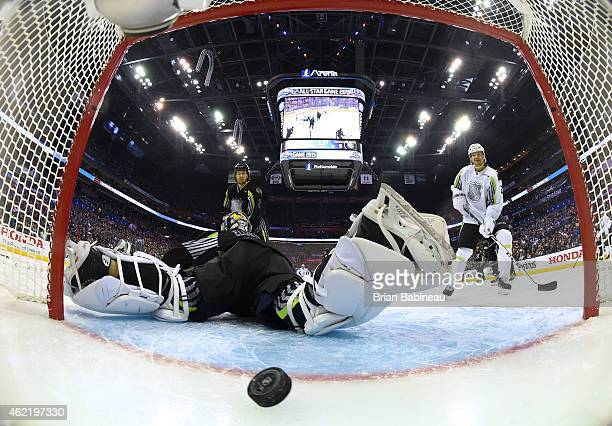Duncan Keith of the Chicago Blackhawks and Team Foligno and Patrik Elias of the New Jersey Devils and Team Toews watch the puck bounce in the net...