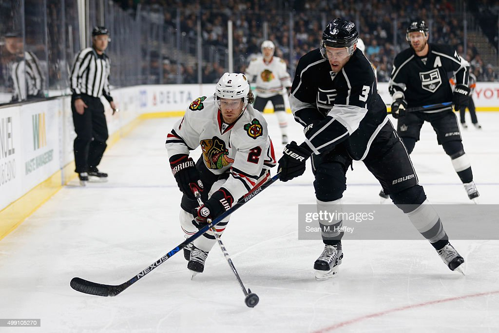 Duncan Keith #2 of the Chicago Blackhawks battles with Brayden McNabb #3 of the Los Angeles Kings for a loose puck during the second period of a game at Staples Center on November 28, 2015 in Los Angeles, California.