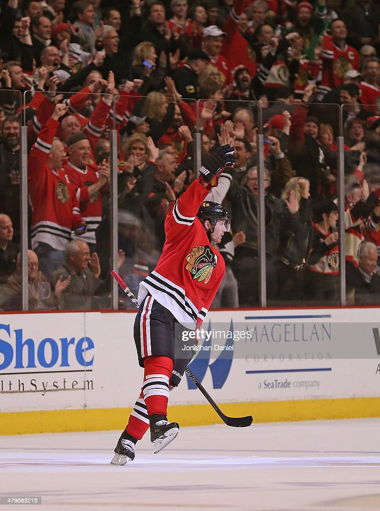 Duncan Keith #2 of the Chicago Blackhawks celebrates his first period goal against the St. Louis Blues at the United Center on March 19, 2014 in Chicago, Illinois.