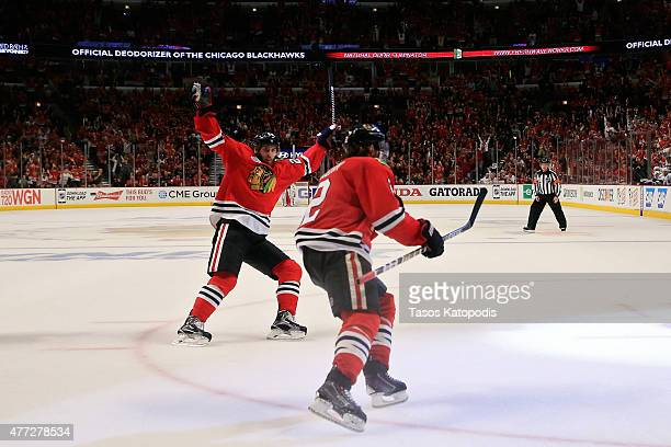 Duncan Keith of the Chicago Blackhawks celebrates with teammate Brandon Saad after scoring a goal in the second period against Ben Bishop of the...