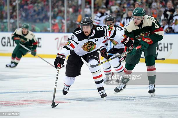Duncan Keith of the Chicago Blackhawks chases the puck against Charlie Coyle of the Minnesota Wild in the first period of the 2016 Coors Light...