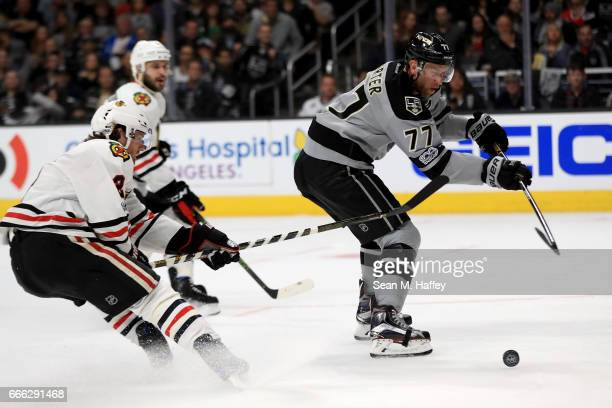 Duncan Keith of the Chicago Blackhawks defends against Jeff Carter of the Los Angeles Kings as he shoots during the second period of a game at...