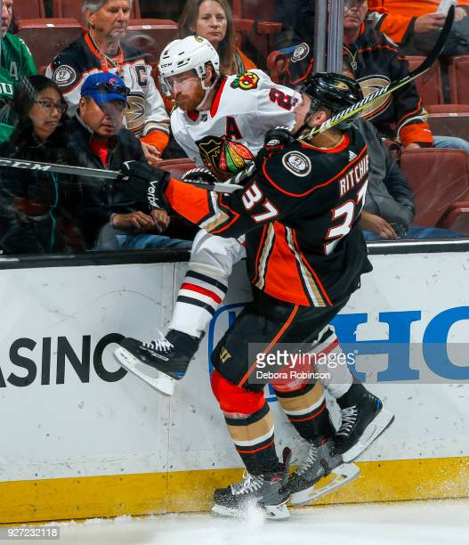 Duncan Keith of the Chicago Blackhawks is checked by Nick Ritchie of the Anaheim Ducks during the second period of the game at Honda Center on March...