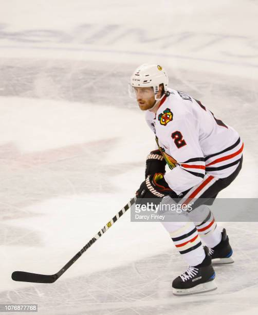 Duncan Keith of the Chicago Blackhawks keeps an eye on the play during second period action against the Winnipeg Jets at the Bell MTS Place on...