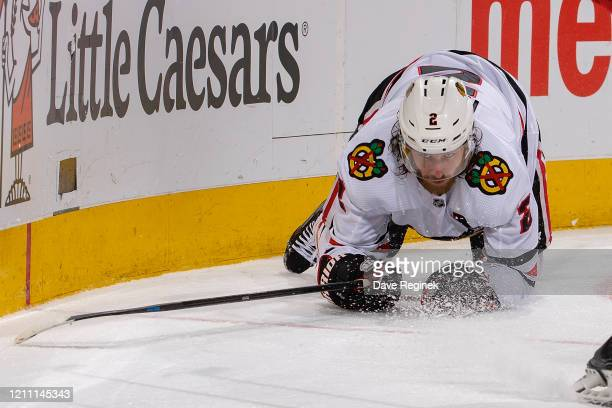 Duncan Keith of the Chicago Blackhawks looks for the puck on his knees against the Detroit Red Wings during an NHL game at Little Caesars Arena on...