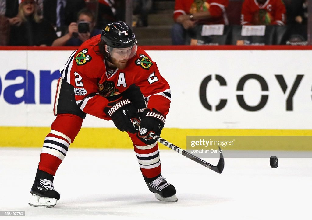 Duncan Keith #2 of the Chicago Blackhawks passes the puck against the Vancouver Canucks at the United Center on March 21, 2017 in Chicago, Illinois. The Canucks defeated the Blackhawks 5-4 in overtime.