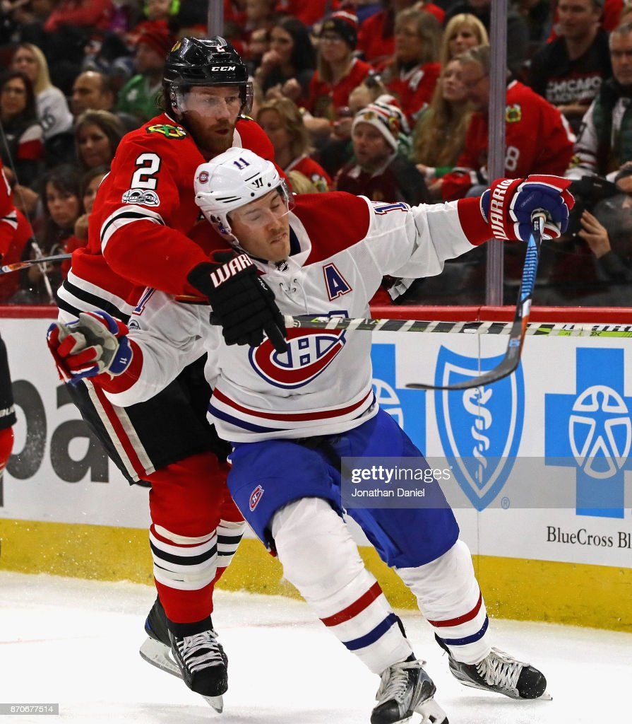 Duncan Keith #2 of the Chicago Blackhawks pressures Brendan Gallagher #11 of the Montreal Canadiens at the United Center on November 5, 2017 in Chicago, Illinois.