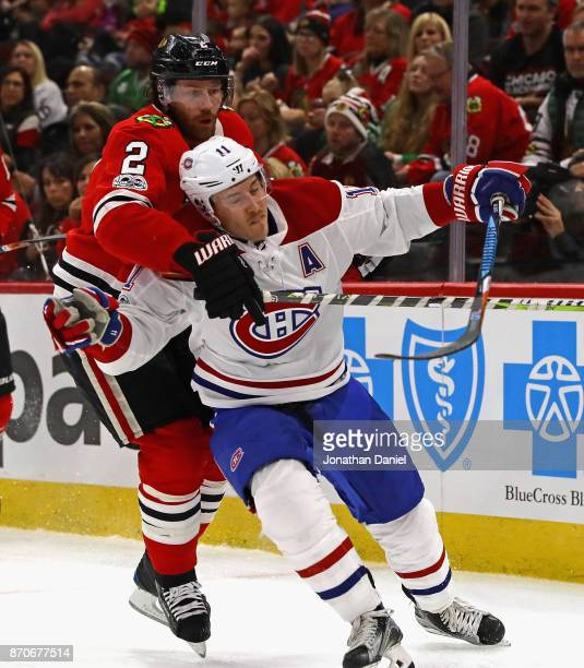 Duncan Keith of the Chicago Blackhawks pressures Brendan Gallagher of the Montreal Canadiens at the United Center on November 5 2017 in Chicago...