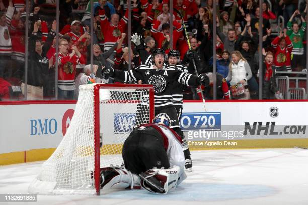 Duncan Keith of the Chicago Blackhawks reacts after scoring the game-winning goal in overtime against the Colorado Avalanche at the United Center on...