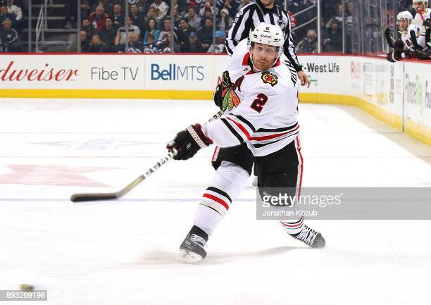 Duncan Keith of the Chicago Blackhawks shoots the puck down the ice during third period action against the Winnipeg Jets at the Bell MTS Place on...