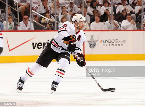 Duncan Keith of the Chicago Blackhawks skates with the puck against the Phoenix Coyotes in Game Five of the Western Conference Quarterfinals during...