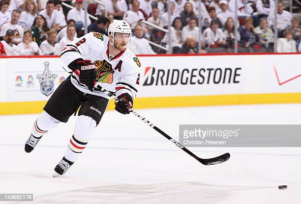 Duncan Keith of the Chicago Blackhawks skates with the puck in Game Five of the Western Conference Quarterfinals against the Phoenix Coyotes during...