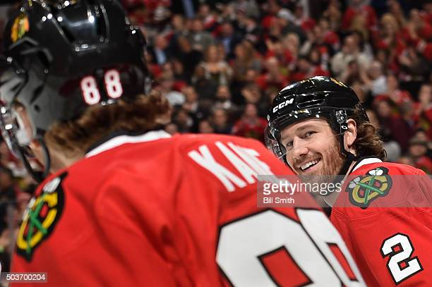 Duncan Keith of the Chicago Blackhawks smiles at Patrick Kane after the Blackhawks scored against the Pittsburgh Penguins in the first period of the...