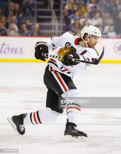 Duncan Keith of the Chicago Blackhawks takes a shot on goal during third period action against the Winnipeg Jets at the Bell MTS Place on November 29...