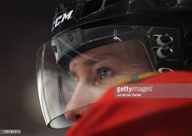 Duncan Keith of the Chicago Blackhawks watches as his teammates take on the Winnipeg Jets at the United Center on October 13, 2011 in Chicago,...