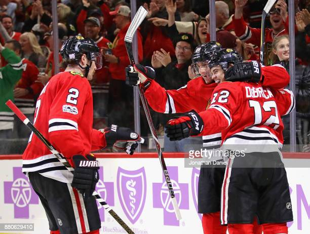 Duncan Keith Patrick Kane and Alex DeBrincat of the Chicago Blackhawks celebrate DeBrincats' third goal of the game in the second period against the...