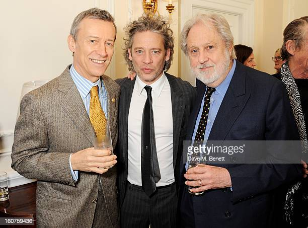 Duncan Kenworthy Dexter Fletcher and Lord Puttnam attend a drinks reception awarding Sir Alan Parker the BAFTA Fellowship supported by Hackett at The...