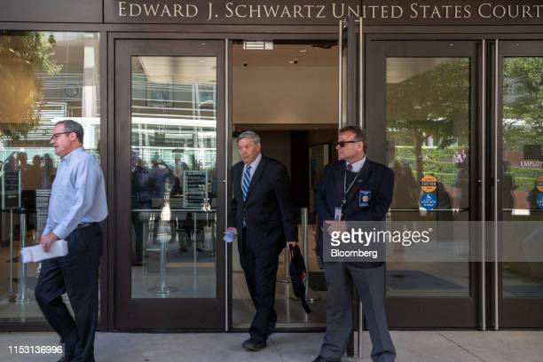 Duncan Lee Hunter former representative for California center exits from a federal court while his son Representative Duncan Hunter a Republican from...