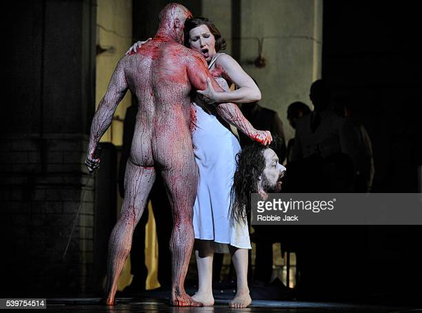 """Duncan Meadows as Naaman and Angela Denoke as Salome in the Royal Opera's productin of Richard Strauss's """"Salome"""" directed by David McVicar and..."""