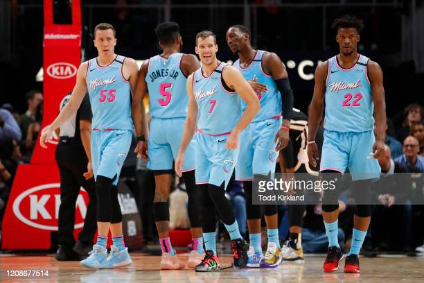 Duncan Robinson Derrick Jones Jr #5 Goran Dragic Bam Adebayo and Jimmy Butler of the Miami Heat make their way back to the bench during a break in...