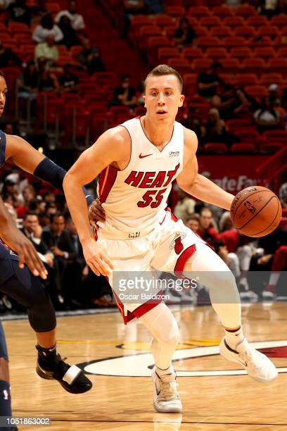 Duncan Robinson of the Miami Heat handles the ball against the New Orleans Pelicans during a preseason game on October 10 2018 at American Airlines...