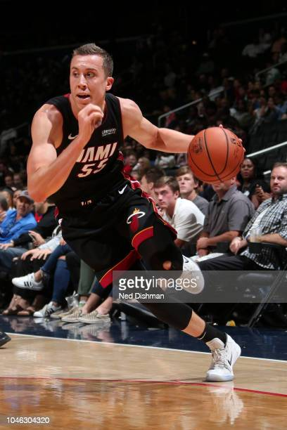 Duncan Robinson of the Miami Heat handles the ball against Washington Wizards during a preseason game on October 5 2018 at Capital One Arena in...