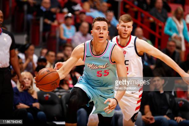 Duncan Robinson of the Miami Heat handles the ball during the game against the Washington Wizards on December 6 2019 at American Airlines Arena in...