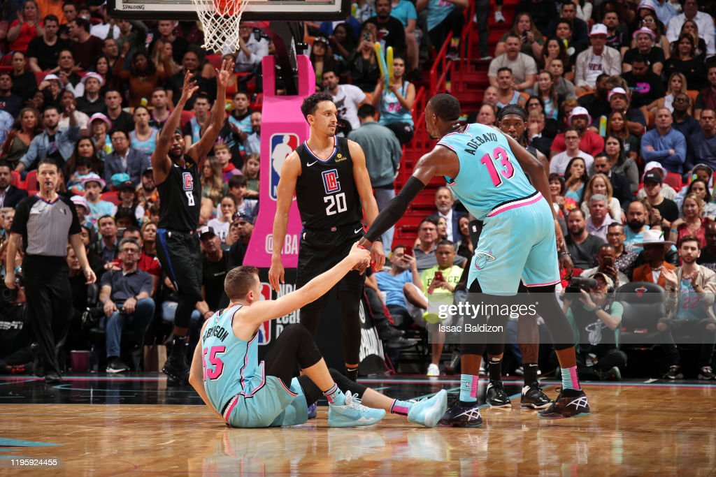 Duncan Robinson Of The Miami Heat Helps Up Bam Adebayo Of The Miami News Photo Getty Images