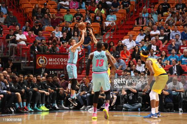 Duncan Robinson of the Miami Heat shoots the ball during a game against the Indiana Pacers on December 27 2019 at American Airlines Arena in Miami...