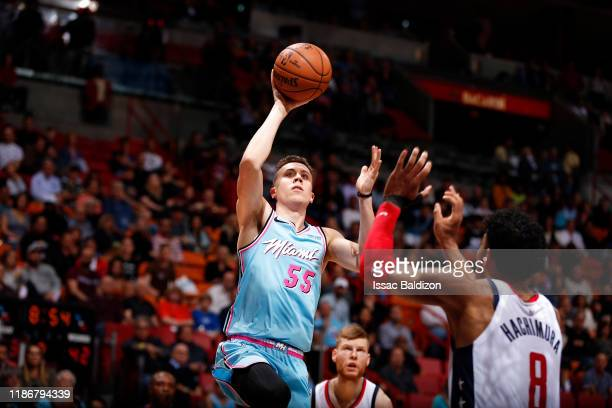 Duncan Robinson of the Miami Heat shoots the ball during the game against the Washington Wizards on December 6 2019 at American Airlines Arena in...
